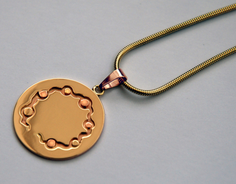 Native American Ojibwe-style gold pendant A River Flows Through Our Hearts