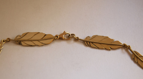 Gold eagle feather fastening of the necklace Spirit of the Three Fires
