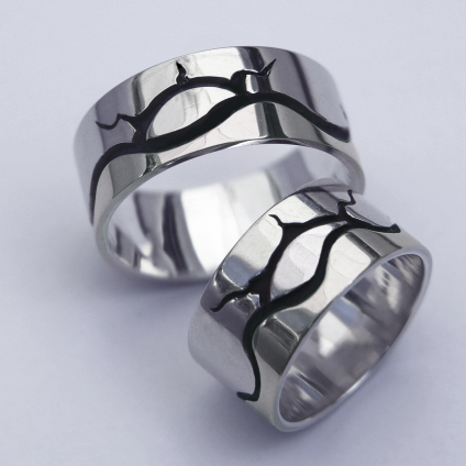 Silver pictographic overlay wedding rings by Zhaawano
