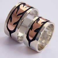 Silver overlay wedding rings with rose gold eagle feather inlays
