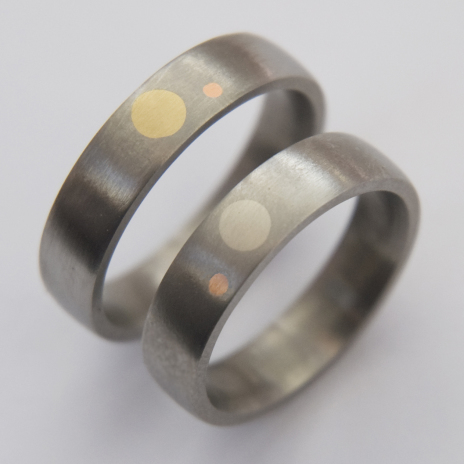 Giizhigo-aadisookaanag Ojibwe titanium gold inlay wedding rings