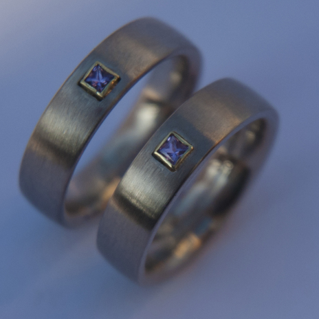 Palladium white gold wedding rings set with amethyst The Color of Love