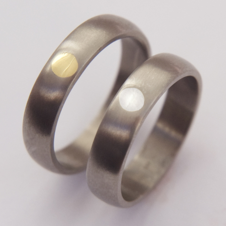 Each side Of The Winter Sky titanium Native American wedding rings with gold inlay