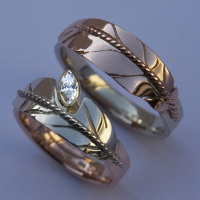 Look Within American wedding rings of white and red gold set with diamond