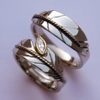 Oshkigin New Growth white gold eagle feather rings featuring a marquise-cut diamond