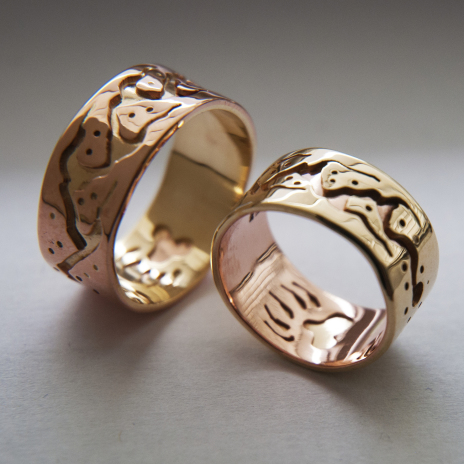 Native American wedding rings depicting the Midewiwin Life Road