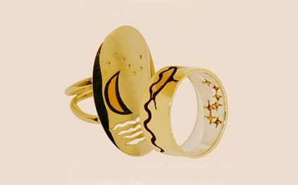 Ojibwe-inspired gold wedding rings featurin the Fishere Star constellation