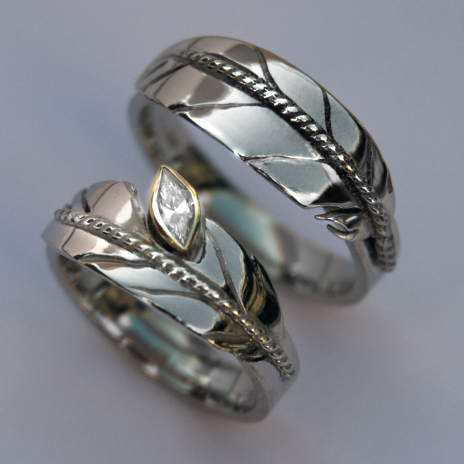 Oshkigin Ojibwe eagle feather wedding rings set Love