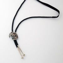 Hawk head bolo tie with plain leather cord
