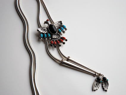 Giniw the Black Headed War Eagle is a model for this Thunderbird bolo tie