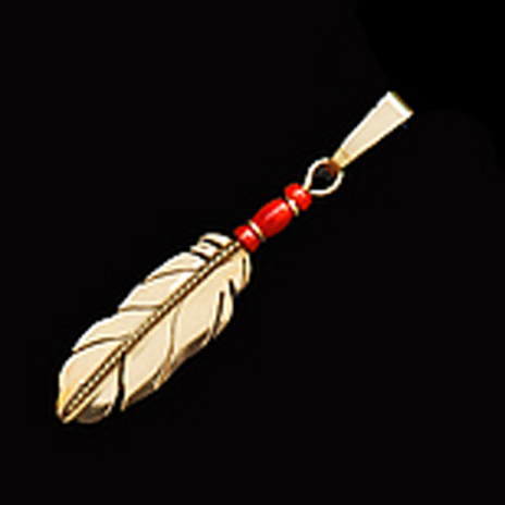 Native american-inspired gold eagle feather jewelry handcrafted by Zhaawano