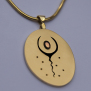 Graphic outline drawing overlay style gold and silver pendant The Spirit Sings