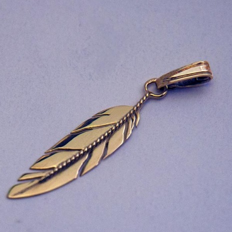 Symbol of Love Native American eagle feather pendant designed by Zhaawano Giizhik