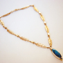 Grandmother's Journey Ojibwe gold turquoise sapphire eagle feather necklace