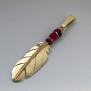 Native American eagle feather pendant of gold and red coral