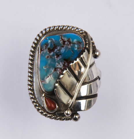 Thunder Leaf silver and turquoise ring with a Native American theme