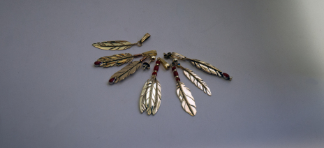 Collection of patented gold eagle feather jewelry designed and handcrrafted by Zhaawano Giizhik.