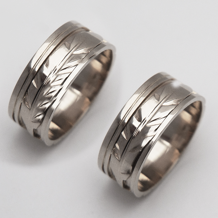 Oshki-waaseyaaban eagle feather designer wedding rings