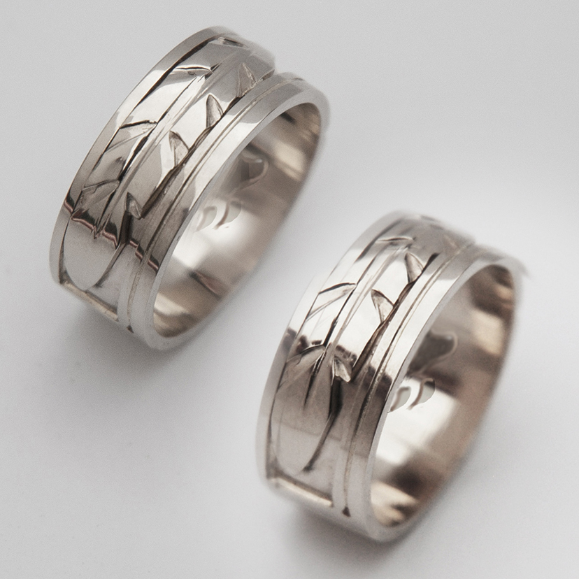 New Dawn white gold wedding rings with bear paw interiors