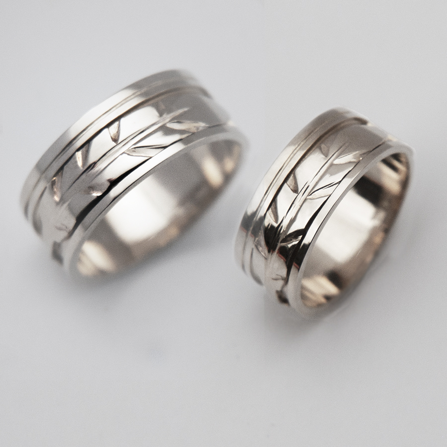 White gold eagle feather designer rings designed by Zhaawano Giizhik