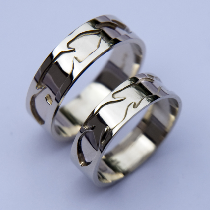 Native American Ojibwe overlay feather rings of white gold titled Izhinaamowin