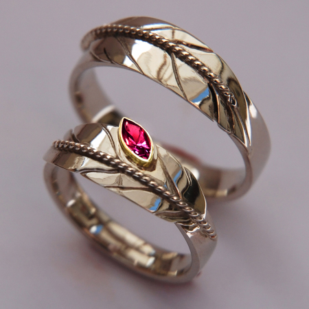 White gold eagle feather wedding rings set with marquise ruby