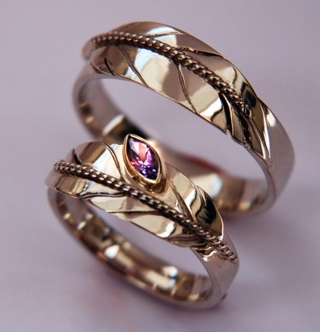 Native American Ojibwe eagle feather wedding rings Nigaganoonaamin Manidoo