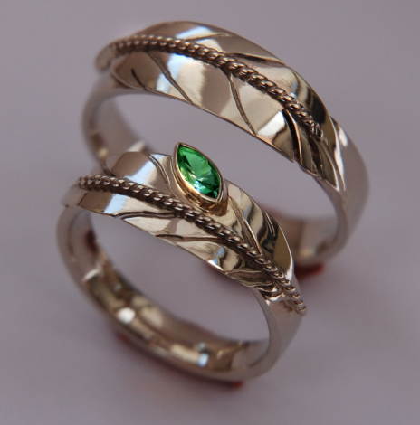 Ojibwe-style white gold Native American eagle feather wedding rings set with emerald