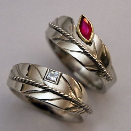 Giizhig-enaabandangig eagle feather rings by Zhaawano Giizhik