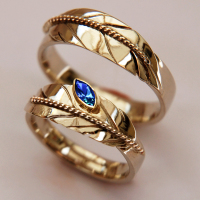 Upright Lives two-tone eagle feather wedding rings designed and handcrafted by Zhaawano