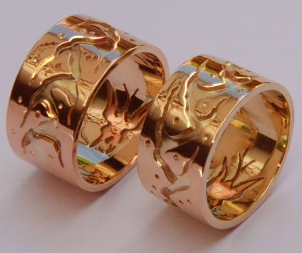 Anishinaabe gold wedding rings depicting a Midewiwin Life Road and butterflies