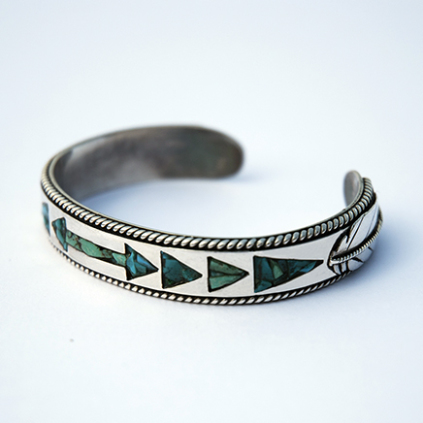 Wiinabozho's Bow sterking silver cuff bracelet inlaid with turquoise