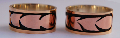 Set of wedding bands featuring stylized hawk feathers