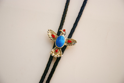 Image of the bolo tie titled Giizisogekek (Sun Hawk) handcrafted by Woodland artist jeweler Zhaawano