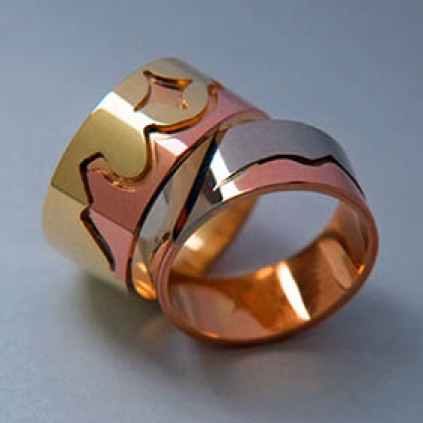 Ojibwe Sleeping Bear Dunes wedding rings by Zhaawano Giizhik
